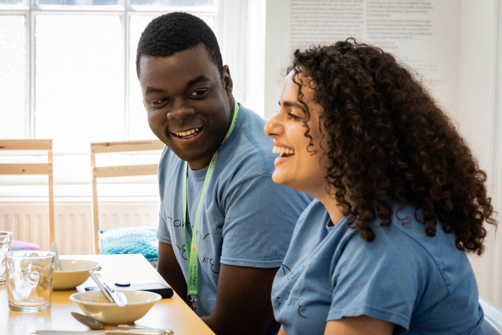 Photo of two volunteers sitting, talking